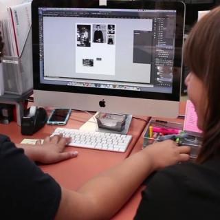 digital-arts-studio-staff-on-computer